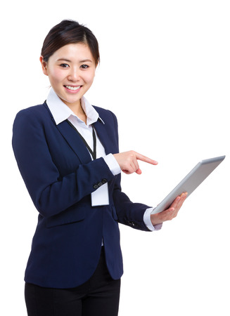 Businesswoman pointing to tablet photo