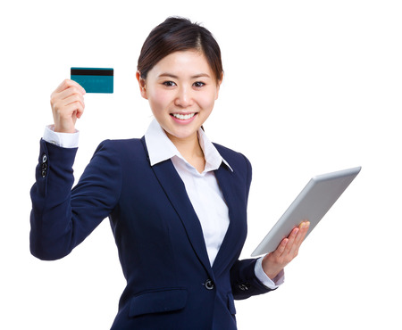 topicality: Businesswoman with tablet and showing credit card