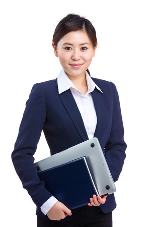 Businesswoman with laptop and notebook photo
