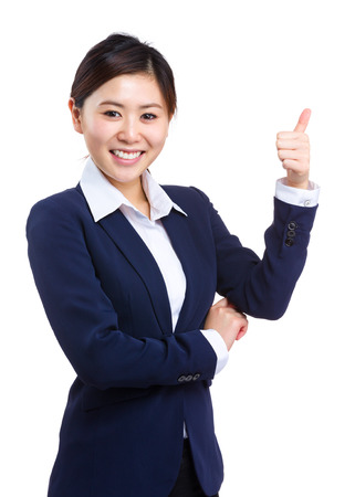 Smiling business woman showing thumb up photo