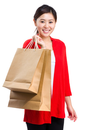 Happy smiling woman with shopping bag photo