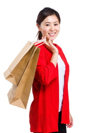 Shopper woman holding shopping bag photo