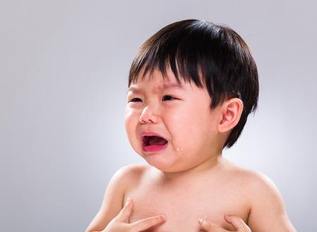 crying child: Little boy has skin problem