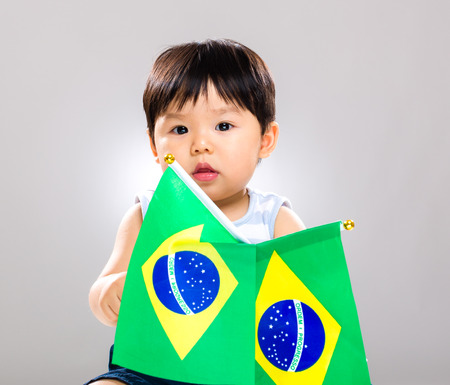 Little baby holding barzil flag photo