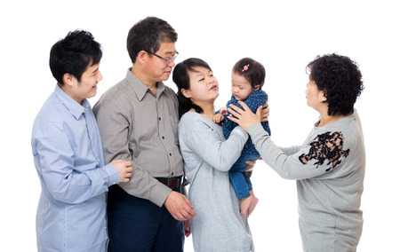 three generation: Happy family looking at little girl Stock Photo