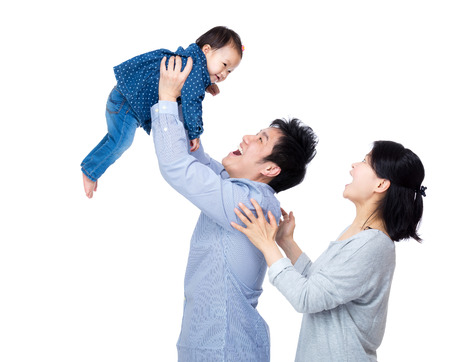 Asia father throw his baby up with smile wife photo