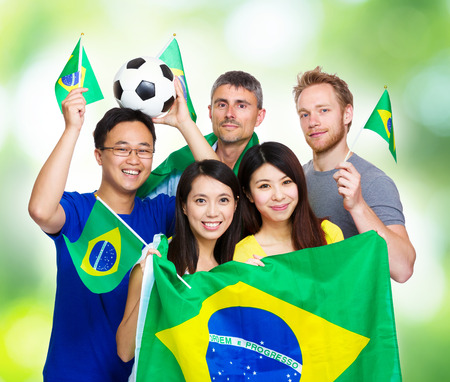 Excited soccer fans from different country photo