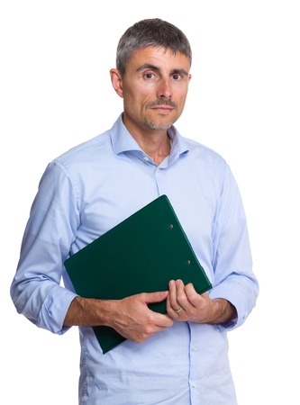 causal clothing: Serious caucasian old man holding clipboard Stock Photo