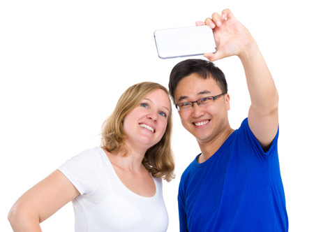 Two smiling friends taking selfie photo