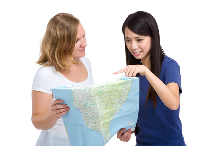 Girl looking at map with different country photo