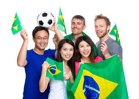 Friend holding Brazilian flag, football lovers photo