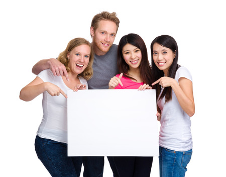 Group of people with diverse ethnicities holding blank sign for your text photo