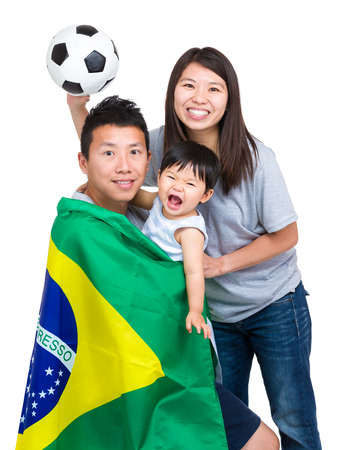 Football supporter of asian family photo