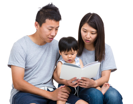 Asian parent reading booking with baby son photo