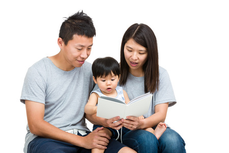 causal clothing: Asian family reading book together