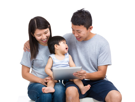 Asian family using tablet photo