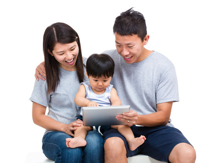 Parent using tablet with thier baby son photo