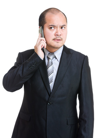 Angry businessman talking on phone photo