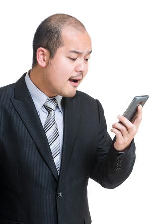 Angry businessman shouting on mobile photo