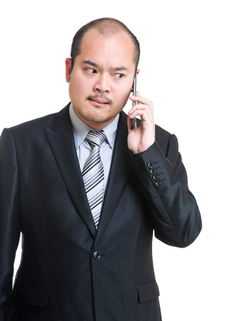 Angry businessman using mobile photo