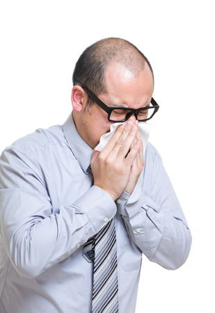 Businessman sneeze photo