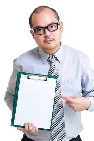 Businessman show clipboard with finger photo