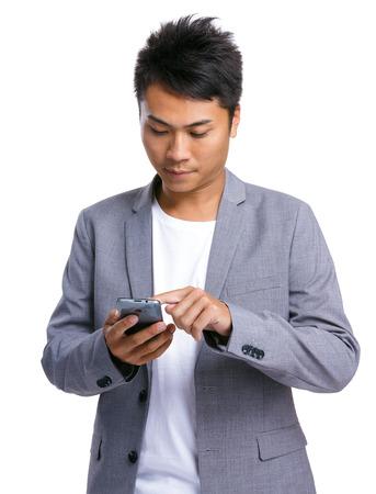 causal clothing: Asian man use phone Stock Photo