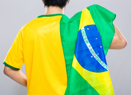 supporter: Brazilian football supporter hold with Brazil flag