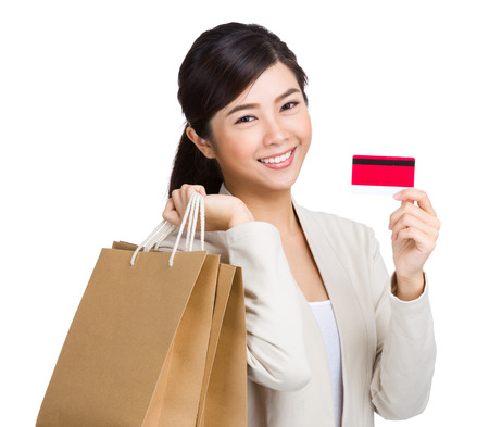 Happy woman using credit card for shopping photo