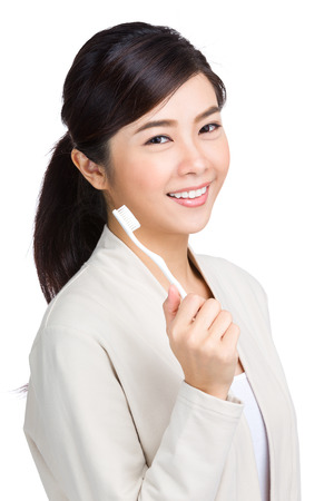dental background: Woman holding toothbrush