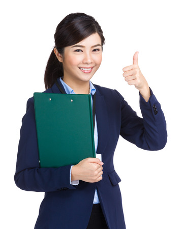 Businesswoman holding clipboard showing thumb up photo