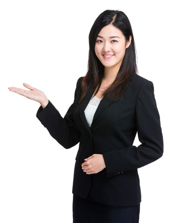 Business woman with open palm photo
