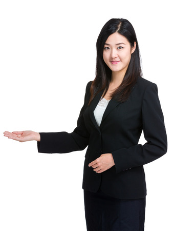 Business woman with hand present photo