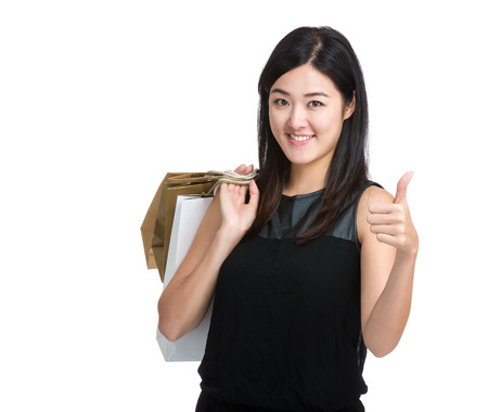 Asian woman hold with shopping bag and thumb up photo