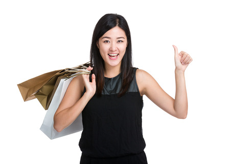 Woman with shopping bag and thumb up photo