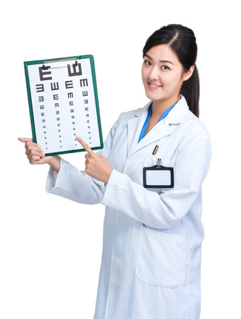 Female doctor hold with eye chart photo