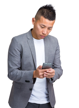 causal clothing: Young businessman using mobile phone