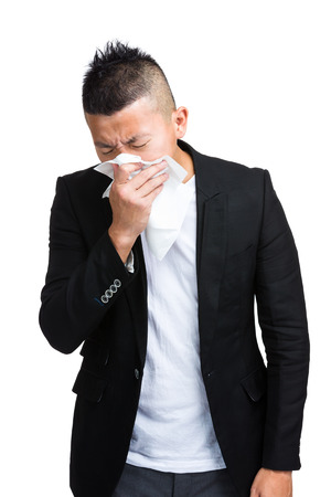 Asian man sneeze photo