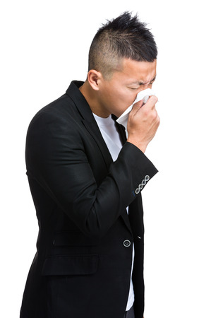 Businessman suffer from nose allergy photo