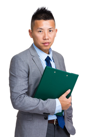 Businessman hold clipboard photo