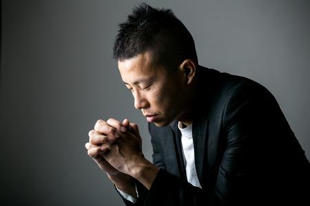 Praying man photo