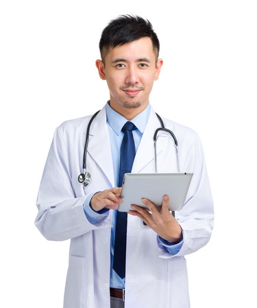 Asian male doctor using tablet photo