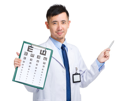 Male doctor holding eye chart and pen pointing up photo