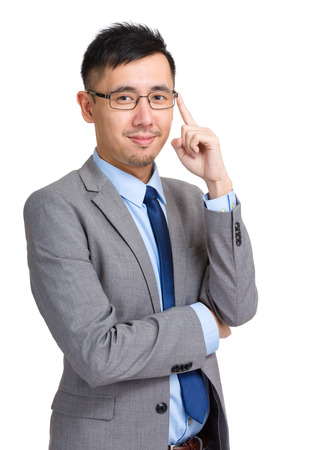 adjust: Businessman adjust his glasses