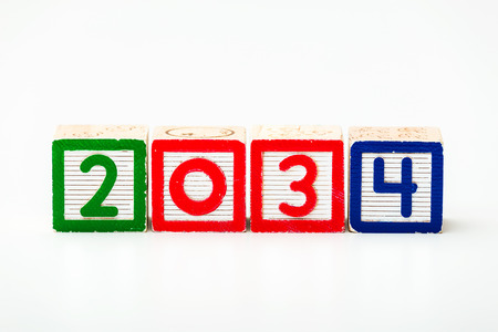 play date: Wooden block for year 2034 Stock Photo