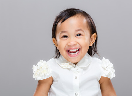 babies laughing: Happy mixed race girl Stock Photo