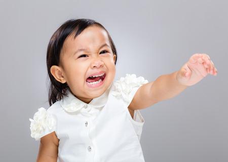 temper: Little girl feel upset and hand raised up Stock Photo