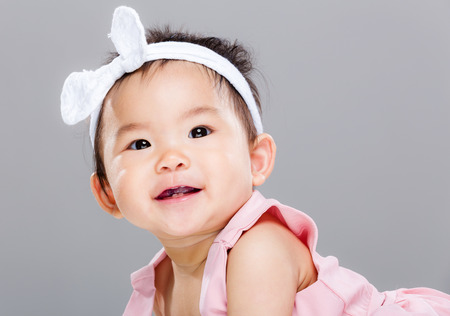 Adorable smiling baby girl photo
