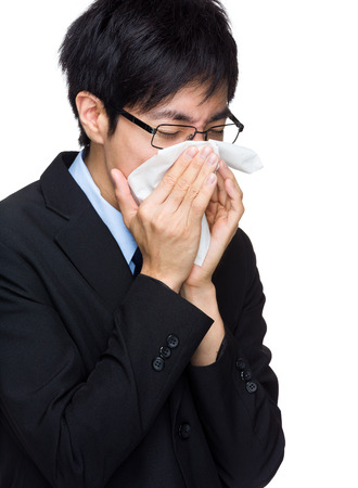 Asian businessman sneezing photo