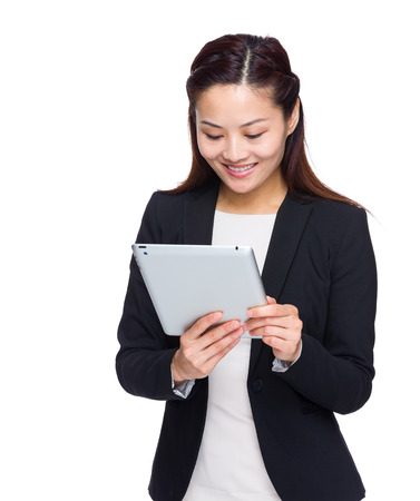 Asian business woman look at digital tablet photo